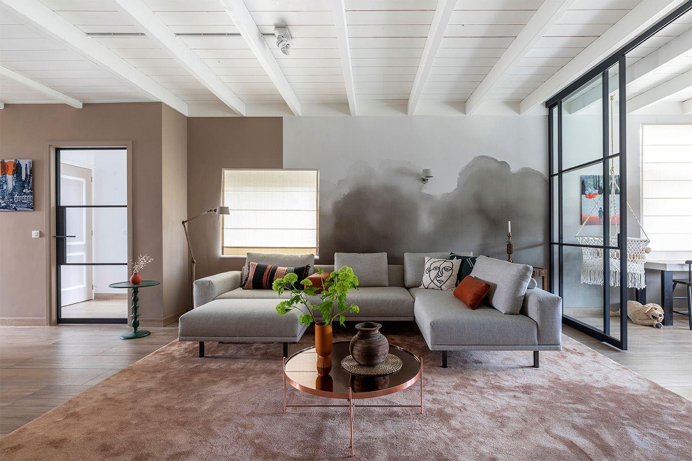 Calm but tough interior with watercolour wallpaper